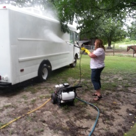 Laurie washing the weenie wagon